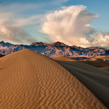 Sand dunes and storm clouds, Death Valley, California.