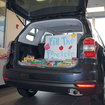 Subaru of Puyallup filled a Subaru Forester with school supplies for Tacoma children.