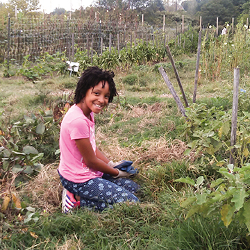 Alexa Diggs, 11, at Farming in the City.