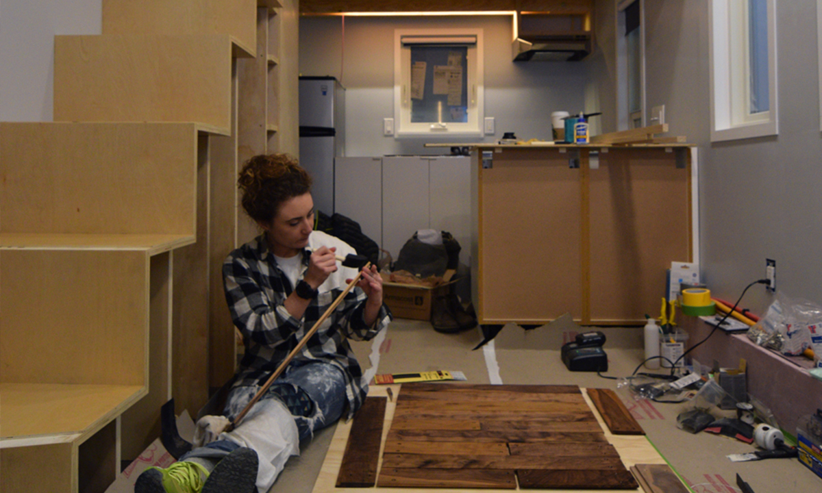 Samantha finishing the reclaimed and re-milled walnut that was used to scent the bathroom.